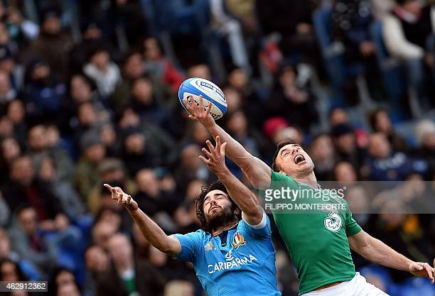 Ireland's wing Tommy Bowe jumps for the ball with Italy's wing Luke McLean during the Six Nations International Rugby Union match between Italy and...