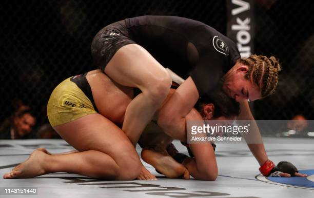 Irene Aldana attempts to submit Bethe Correia in their Bantamweight bout during the UFC 237 event event at Jeunesse Arena on May 11 2019 in Rio de...