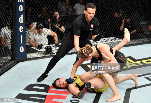 Irene Aldana of Mexico finishes Ketlen Vieira of Brazil in their women's bantamweight bout during the UFC 245 event at TMobile Arena on December 14...