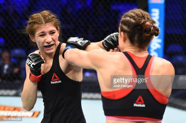 Irene Aldana of Mexico punches Lucie Pudilova of Czech Republic in their women's bantamweight fight during the UFC 228 event at American Airlines...