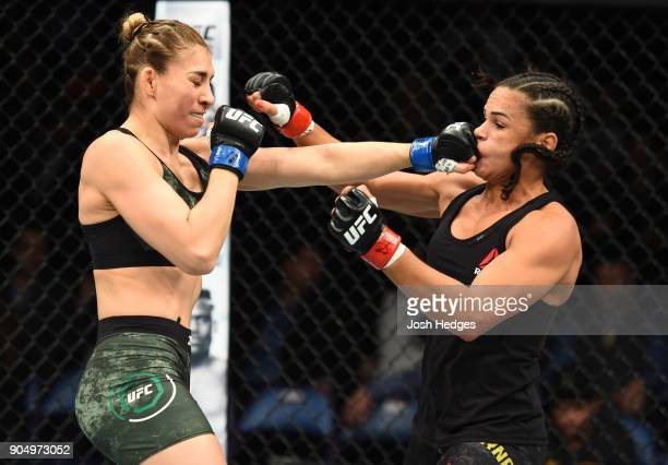Irene Aldana of Mexico punches Talita Bernardo of Brazil in their women's bantamweight bout during the UFC Fight Night event inside the Scottrade...