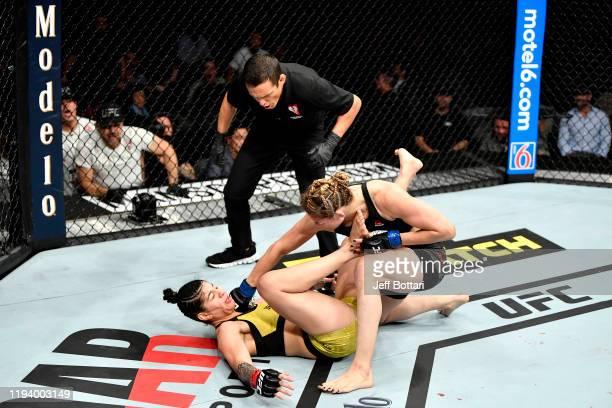 Irene Aldana of Mexico strikes Ketlen Vieira of Brazil in their women's bantamweight bout during the UFC 245 event at TMobile Arena on December 14...