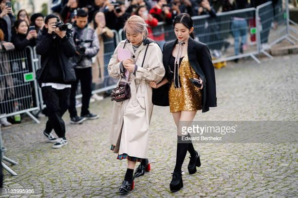 Irene Bae wears a black blazer jacket a golden sequined dress outside Miu Miu during Paris Fashion Week Womenswear Fall/Winter 2019/2020 on March 05...