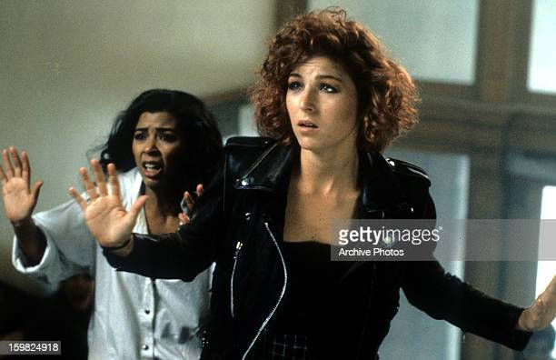Irene Cara and Tatum O'Neal put up their hands in a scene from the film 'Certain Fury' 1985
