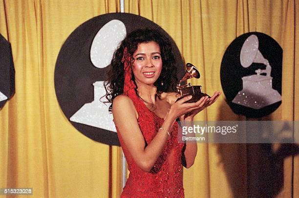 Irene Cara best known as a singer of movie themes holds her award for the song What a Feeling from the movie Flashdance She won the award for Best...