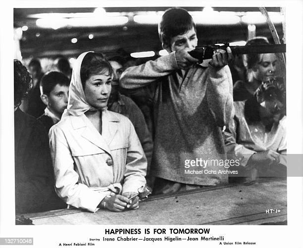 Irene Chabrier at amusement park with Jacques Higelin in a scene from the film 'Happiness Is For Tomorrow' 1961