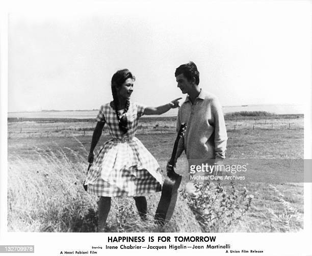 Irene Chabrier walking in the field with Jacques Higelin in a scene from the film 'Happiness Is For Tomorrow' 1961