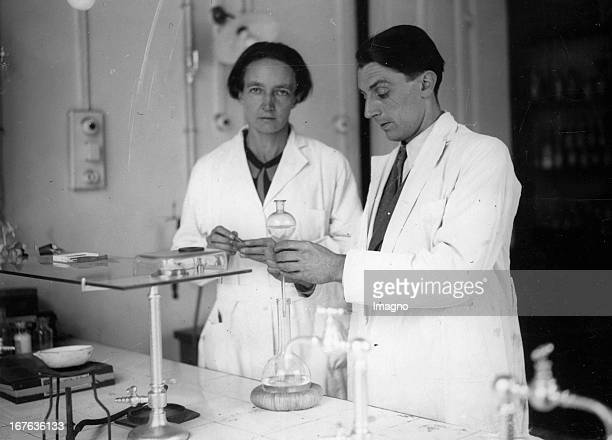 Irene CurieJoliot daughter of Marie Curie with her husband Frédéric Joliot in their laboratory of the institute Curie in Paris Photograph About 1934...