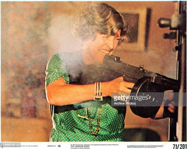 Irene Dailey firing an automatic weapon in a scene from the film 'The Grissom Gang' 1971