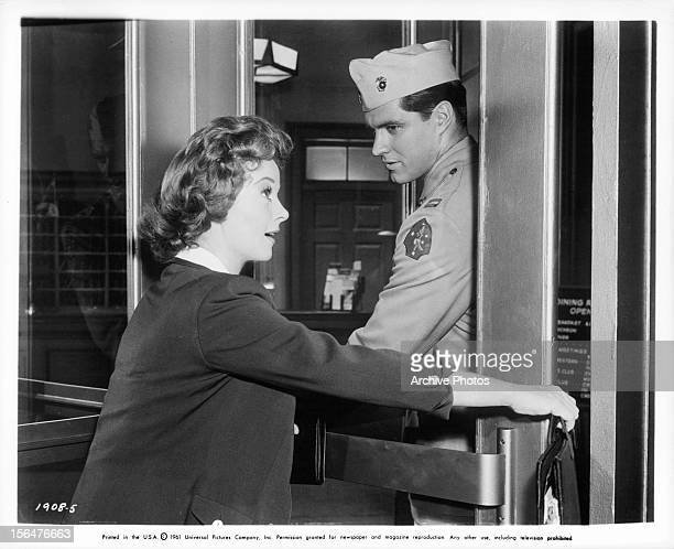 Irene Dunne tries to open a door as John Boles helps her in a scene from the film 'Back Street' 1932