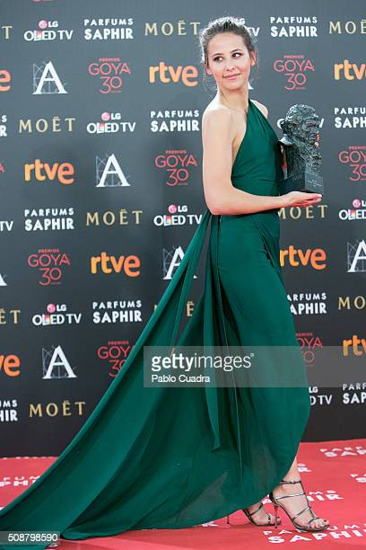 Irene Escolar holds the award for Best New Actress award during the 30th edition of the Goya Cinema Awards at Madrid Marriott Auditorium on February...