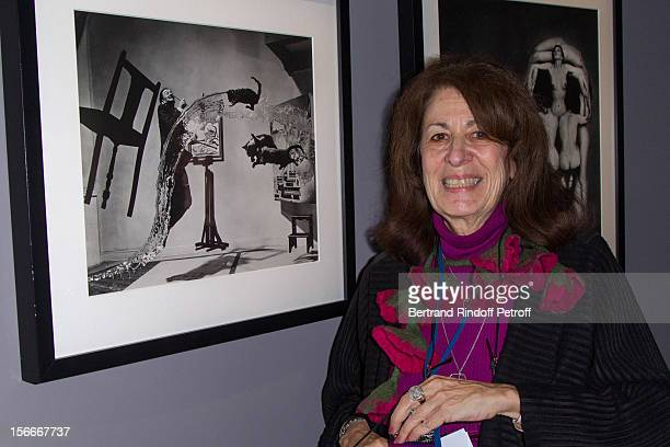 Irene Halsman the daughter of late photographer Philippe Halsman poses by her father's 1948 'Dali Atomicus' as she attends Dali Private Exhibition...