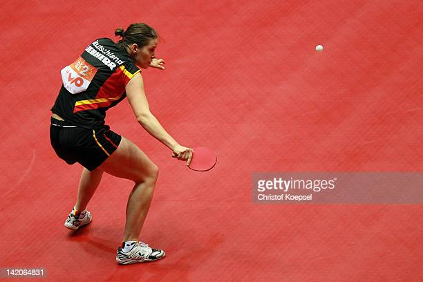 Irene Ivancan of Germany plays a backhand during her match against Kim Jong of North Korea during the LIEBHERR table tennis team world cup 2012...