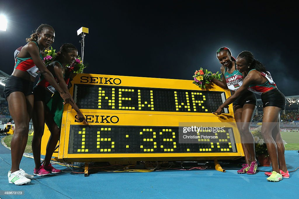 Irene Jelagat, Faith Chepngetich Kipyegon, Mercy Cherono and Hellen Onsando Obiri of Kenya pose together after setting a new world record of 16:33.58 in the Women's 4x1500 metres relay during day one of the IAAF World Relays at the Thomas Robinson Stadium on May 24, 2014 in Nassau, Bahamas.