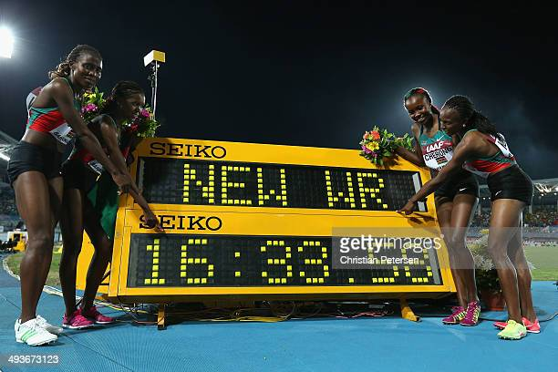 Irene Jelagat Faith Chepngetich Kipyegon Mercy Cherono and Hellen Onsando Obiri of Kenya pose together after setting a new world record of 163358 in...