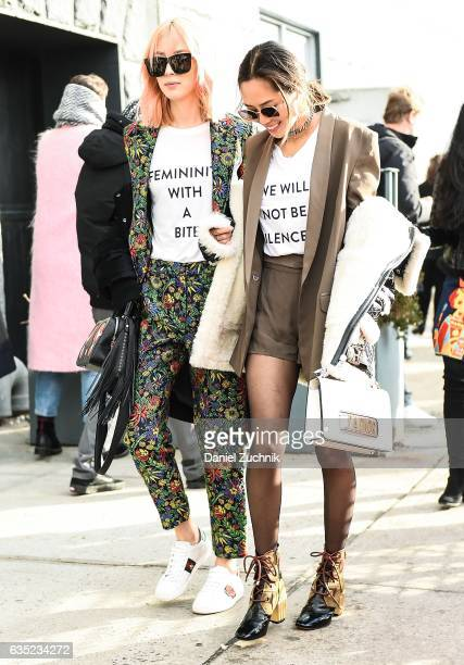 Irene Kim and Aimee Song are seen making a political statement outside of the 31 Phillip Lim show during New York Fashion Week Women's Fall/Winter...