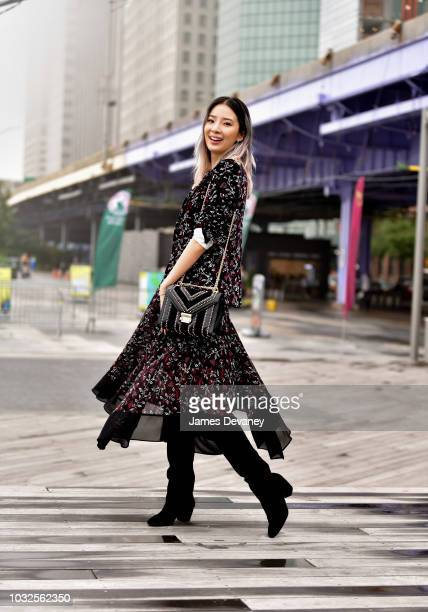 Irene Kim arrives to the Michael Kors fashion show at Pier 17 on September 12 2018 in New York City