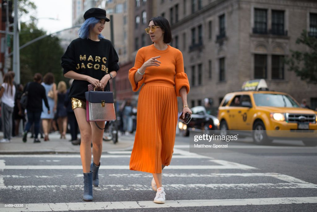 Irene Kim & Eva Chen are seen attending Marc Jacobs during New York Fashion Week wearing Marc Jacobs, Ksenia Schnaider, adidas Originals on September 13, 2017 in New York City.