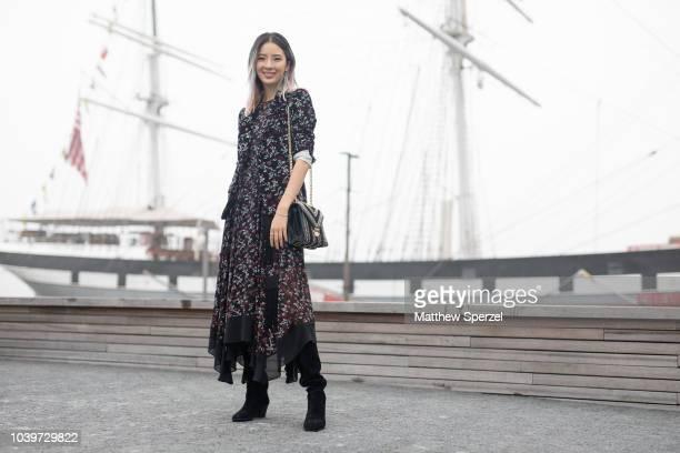 Irene Kim is seen on the street attending New York Fashion Week SS19 wearing Michael Kors on September 12, 2018 in New York City.