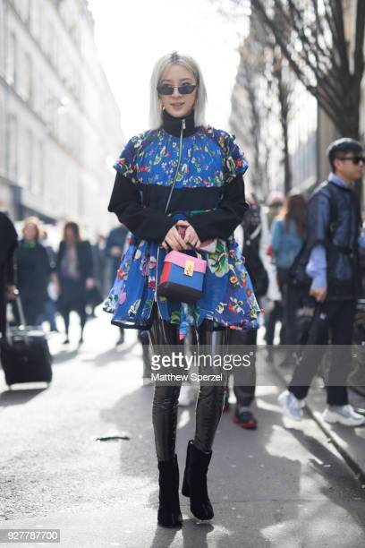 Irene Kim is seen on the street attending Sacai during Paris Women's Fashion Week A/W 2018 wearing a blue Sacai dress on March 5 2018 in Paris France