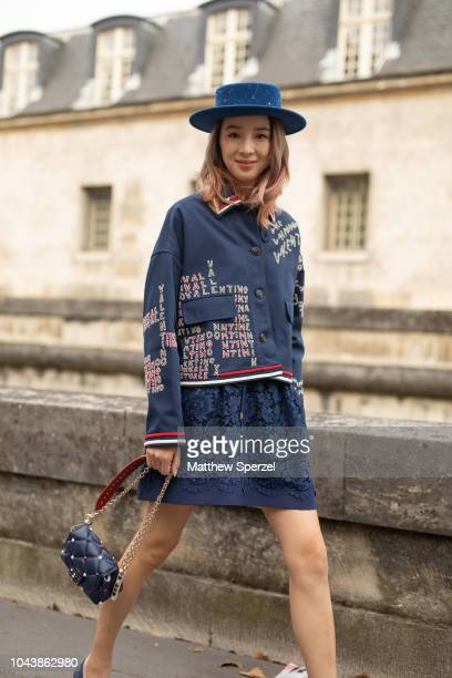 Irene Kim is seen on the street during Paris Fashion Week SS19 wearing Valentino on September 30, 2018 in Paris, France.
