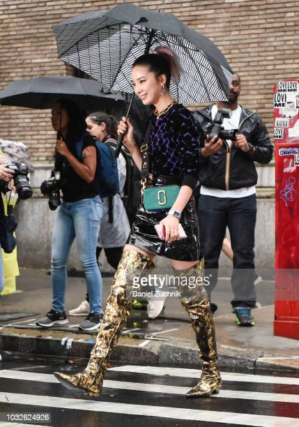 Irene Kim is seen wearing a Marc Jacobs top and Chanel boots outside the Marc Jacobs show during New York Fashion Week Women's S/S 2019 on September...