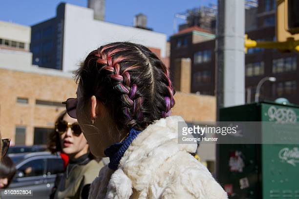 Irene Kim seen at Skylight Clarkson Sq outside the Derek Lam show wearing white fur coat sunglasses and multicolored braids during New York Fashion...
