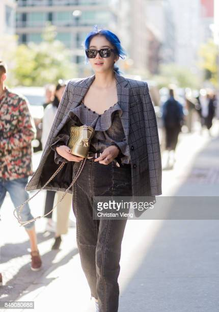 Irene Kim seen in the streets of Manhattan outside Self-Portrait during New York Fashion Week on September 9, 2017 in New York City.