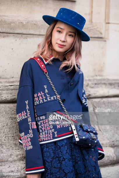 Irene Kim wearing a blue decorated hat blue printed jacket blue Valentino bag and blue lace skirt is seen after the Valentino show on September 30...