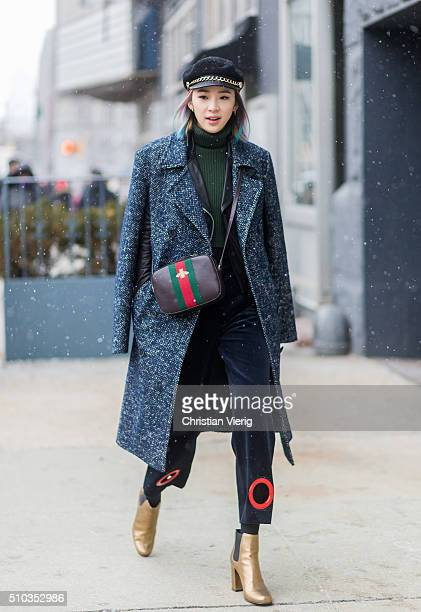 Irene Kim wearing a Eugenia Kim hat a grey Lacoste wool coat blue Simone Porte Jacquemus pants a Gucci bag and Yves Saint Laurent golden boots seen...