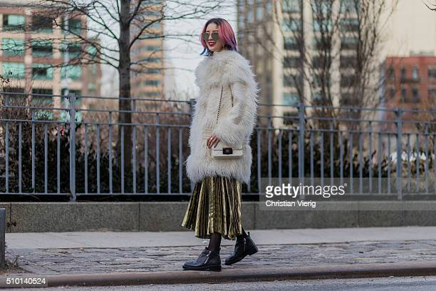 Irene Kim wearing a golden skirt a creme Chanel bag and a creme long fluffy fur coat seen outside Jason Wu during New York Fashion Week Women's...