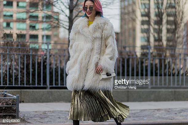 Irene Kim wearing a golden skirt a creme Chanel bag and a creme long fluffy fur coat seen outside Jason Wu during New York Fashion Week Women's...
