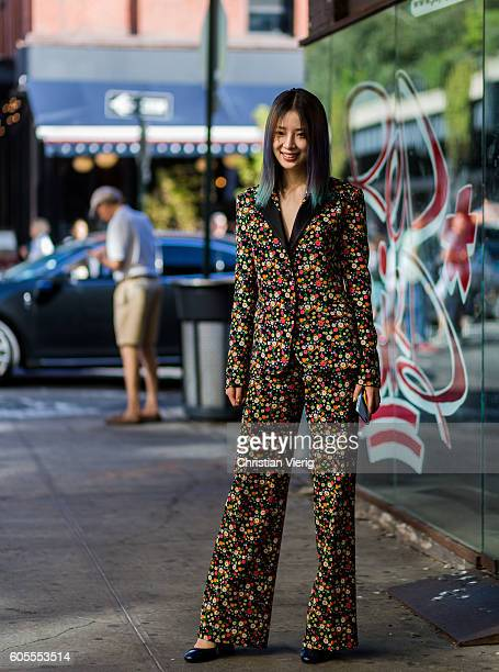 Irene Kim wearing a jumpsuit with floral print outside Tory Burch on September 13 2016 in New York City