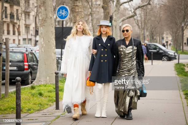 Irene Kim wearing baby blue boater, javy double jacket and knee high white boots outside the Loewe show during the Paris Fashion Week Womenswear...