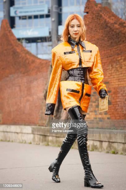 Irene Kim wearing Balmain sequin two-piece and black knee high boots outside the Balmain show during the Paris Fashion Week Womenswear Fall/Winter on...