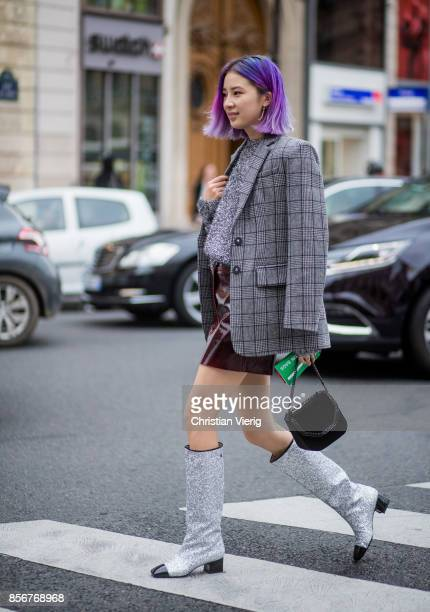 Irene Kim wearing checked blazer glitter Chanel boots Stella McCartney bag seen outside Stella McCartney during Paris Fashion Week Spring/Summer 2018...