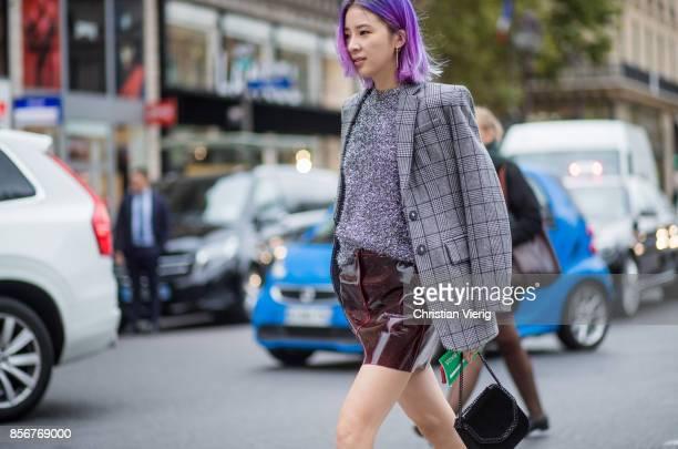 Irene Kim wearing checked blazer glitter Chanel boots Stella McCartney bag seen outside Stella McCartney during Paris Fashion Week Spring/Summer 2018...