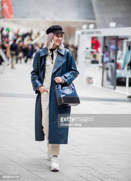 Irene Kim wearing flat cap navy vinyl leather coat Chanel bag beige overall is seen at the Hera Seoul Fashion Week 2018 F/W at Dongdaemun Design...