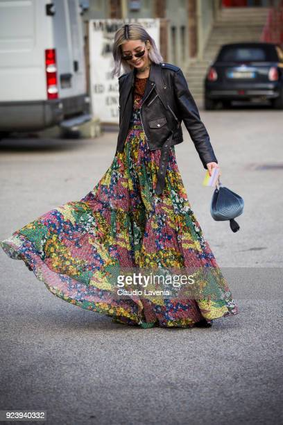 Irene Kim wearing floral dress and black leather jacket is seen outside Missoni show during Milan Fashion Week Fall/Winter 2018/19 on February 24...