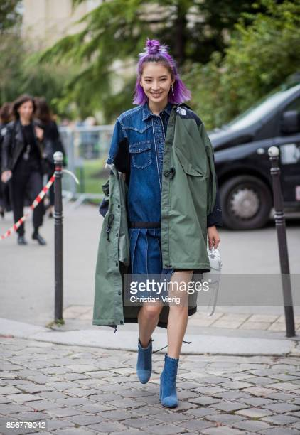 Irene Kim wearing North Face x Sacai coat seen outside Sacai during Paris Fashion Week Spring/Summer 2018 on October 2 2017 in Paris France