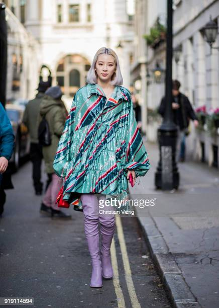 Irene Kim wearing pink overknee boots seen outside Mulberry during London Fashion Week February 2018 on February 16 2018 in London England