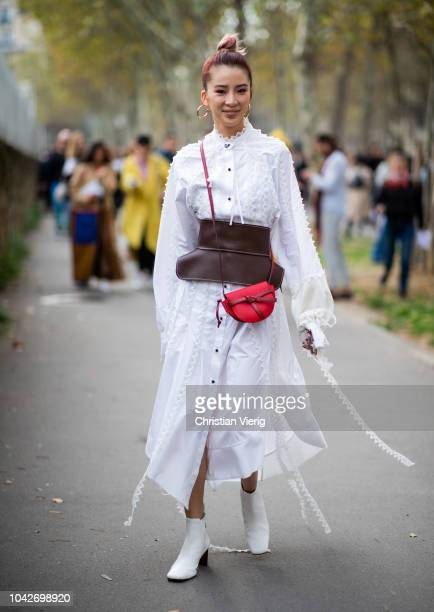 Irene Kim wearing white dress brown corset is seen outside Loewe during Paris Fashion Week Womenswear Spring/Summer 2019 on September 28 2018 in...