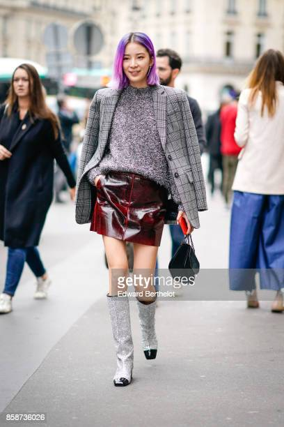 Irene Kim wears a gray tartan blazer jacket a gray top a leather skirt glitter chanel boots has purple pink hair outside Stella Mccartney during...