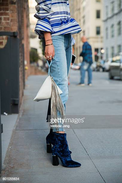 Irene Kim wears a Lucky Chouette offshoulder top Stella McCartney jeans Phillip Lim boots and a Bolon bag at the Thakoon show on September 8 2016 in...