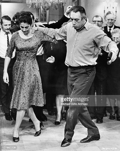 Irene Papas and Anthony Quinn join in a traditional joyful Greek dance in a scene from the film 'A Dream of Kings' 1969