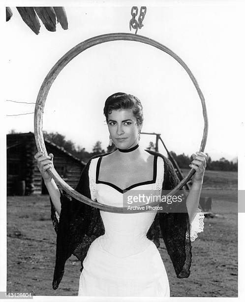 Irene Papas holding large hanging ring on location for the film 'Tribute To A Bad Man', 1956.