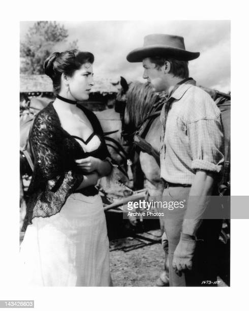 Irene Papas talking to Don Dubbins outside in a scene from the film 'Tribute To A Bad Man', 1956.