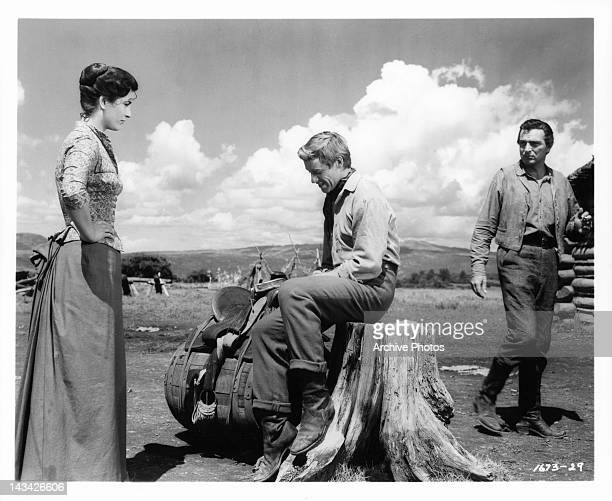 Irene Papas tells Don Dubbins that he's doing good work, as Stephen McNally looks on in a scene from the film 'Tribute To A Bad Man', 1956.