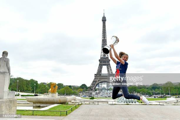 Irene Paredes jumps with the trophy next to the Eiffel Tower during the Celebration of the title of French champion D1 Arkema at Parc des Princes on...