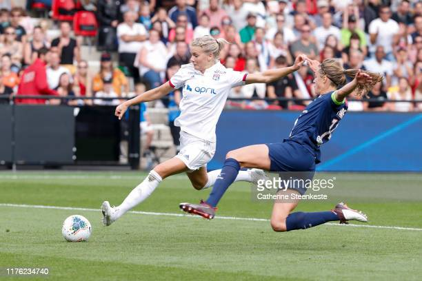 Irene Paredes of Paris SaintGermain challenges Ada Hegerberg of Olympique Lyonnais during the Trophee des Championnes match between Olympique...